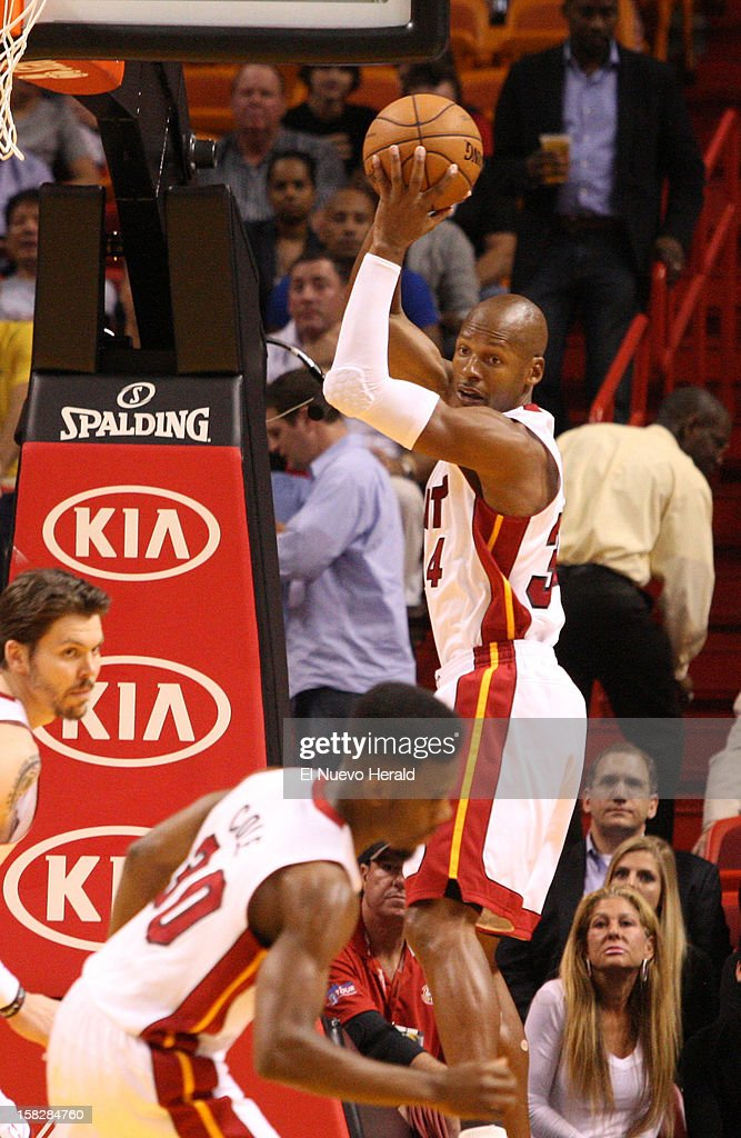 The Miami Heat's Ray Allen, right, takes a rebound in the first half against the Golden State Warriors on Wednesday, December 12, 2012, at the AmericanAirlines Arena in Miami, Florida.