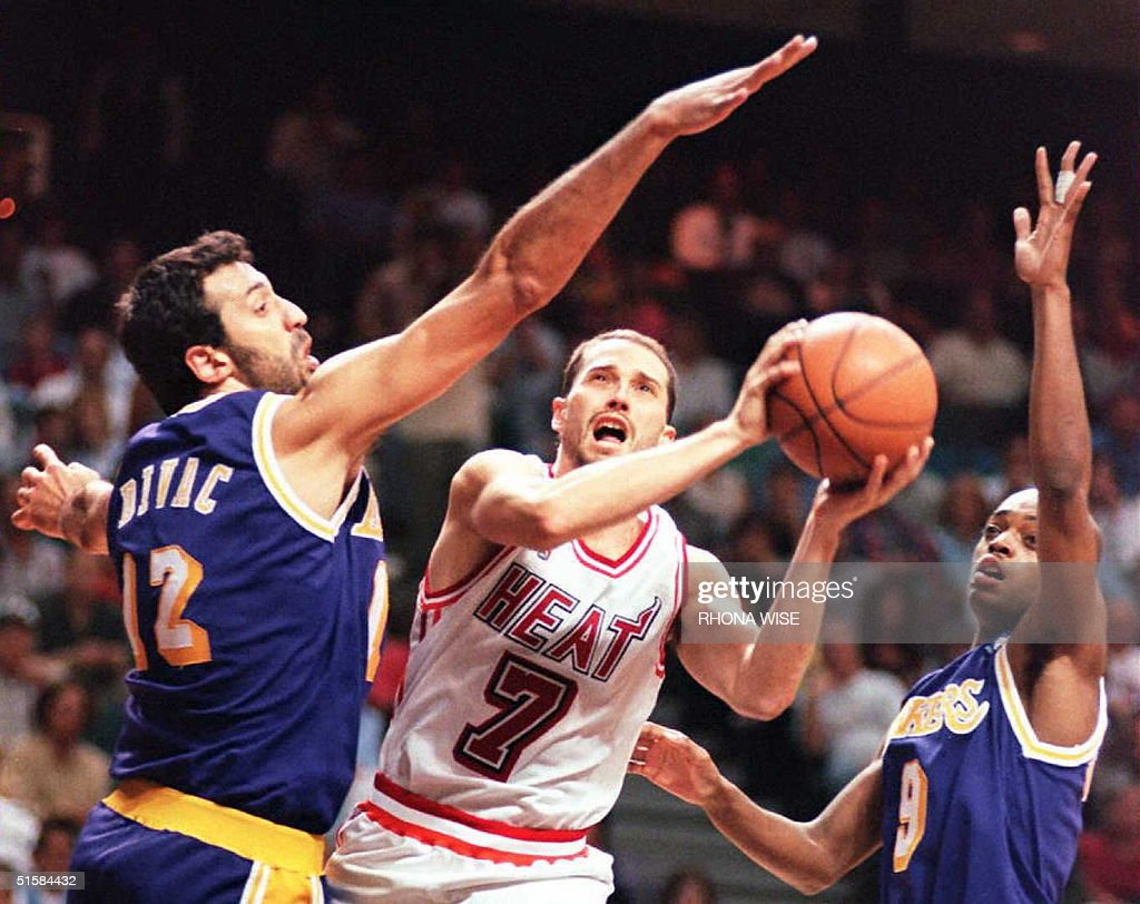 The Miami Heat s Rex Chapman C is defended by th