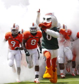 The Miami Hurricane mascot 'Sebastian the Ibis' leads the players onto the field for the spring game between the orange team and the white team on...