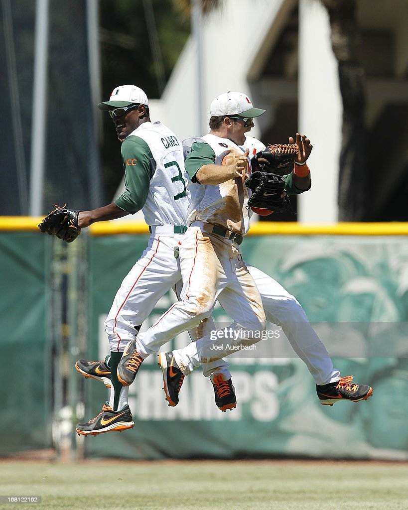 The Miami Hurricanes celebrate their victory against the St John's Red Storm on May 5, 2013 at Alex Rodriguez Park at Mark Light Field in Coral Gables, Florida. Miami defeated St John's 6-4 and swept the weekend series.
