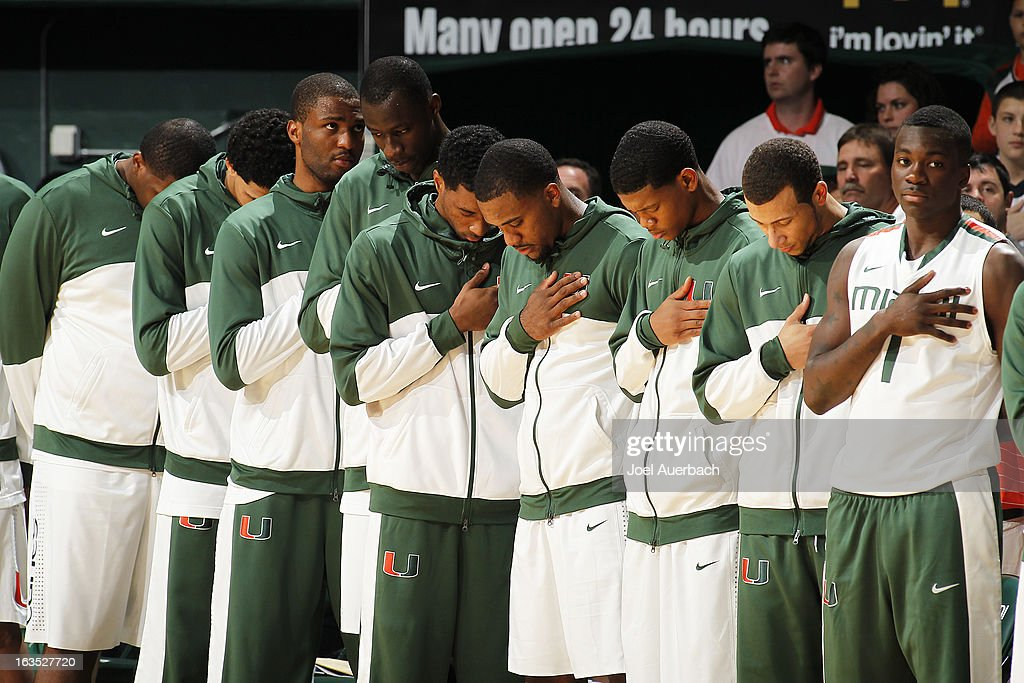 The Miami Hurricanes stand for the playing of the national anthem prior to the game against the Clemson Tigers on March 9, 2013 at the BankUnited Center in Coral Gables, Florida. The Hurricanes defeated the Tigers 62-49 and won the Atlantic Coast Conference Championship.