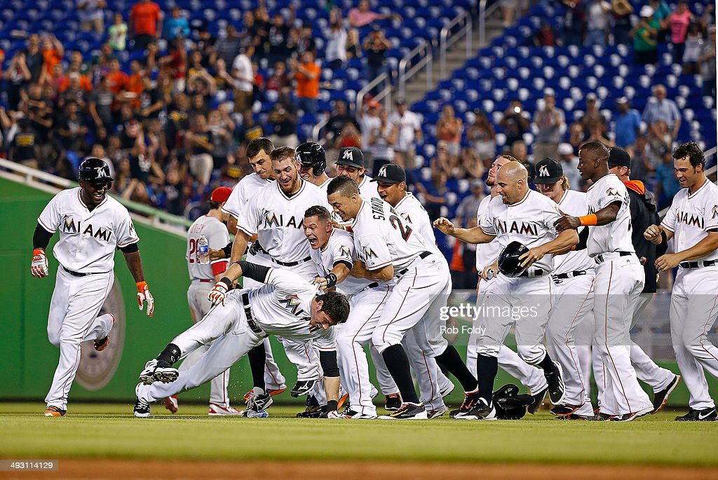 The Miami Marlins celebrate after <a gi-track='captionPersonalityLinkClicked' href=/galleries/search?phrase=Christian+Yelich&family=editorial&specificpeople=9527291 ng-click='$event.stopPropagation()'>Christian Yelich</a> #21 (center left) hit a walk-off single during the ninth inning of the game against the Philadelphia Phillies at Marlins Park on May 22, 2014 in Miami, Florida.