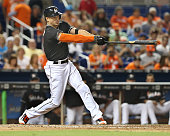 The Miami Marlins' Giancarlo Stanton hits a single in the sixth inning against the New York Mets at Marlins Park in Miami on Saturday July 23 2016...
