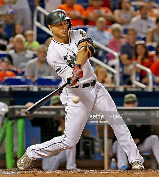 The Miami Marlins' Giancarlo Stanton singles against the Los Angeles Angels on May 28 at Marlins Park in Miami He was hit by a pitch on his right...