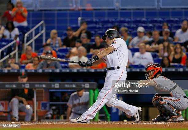 The Miami Marlins' JT Realmuto grounds into a force out scoring teammate Giancarlo Stanton during the first inning against the San Francisco Giants...