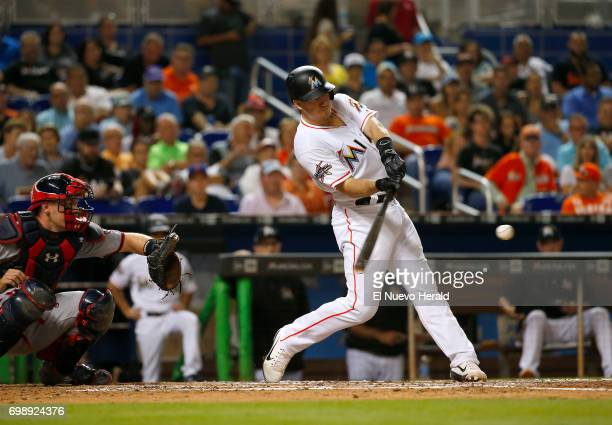 The Miami Marlins' JT Realmuto hits an RBI double during the fourth inning against the Washington Nationals at Marlins Park in Miami on Tuesday June...