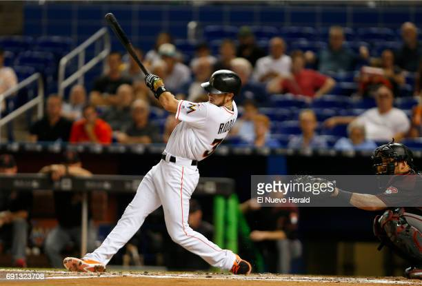 The Miami Marlins' JT Riddle hits a double during the third inning against the Arizona Diamondbacks at Marlins Park in Miami on Thursday June 1 2017