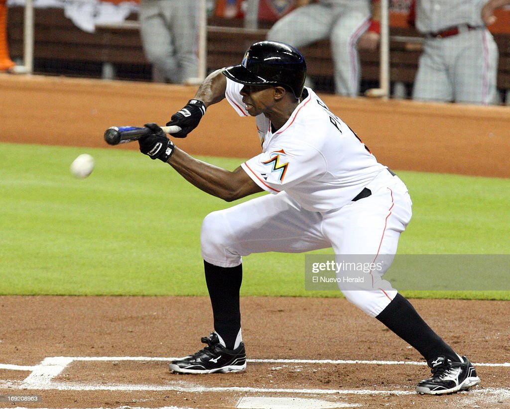 The Miami Marlins' Juan Pierre bunts the ball in the first inning against the Philadelphia Phillies at Marlins Park in Miami, Florida, on Tuesday, May 21 2013.