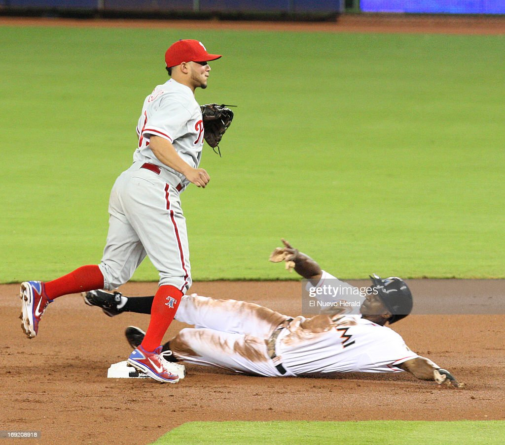 The Miami Marlins' Juan Pierre is retired by Philadelphia Phillies second baseman Freddy Galvis, left, in the first inning at Marlins Park in Miami, Florida, on Tuesday, May 21 2013.