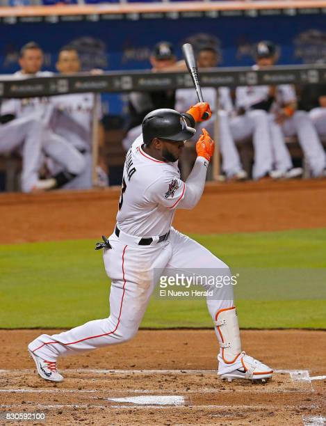 The Miami Marlins' Marcell Ozuna hits a single during the second inning against the Colorado Rockies at Marlins Park in Miami on Friday Aug 11 2017...