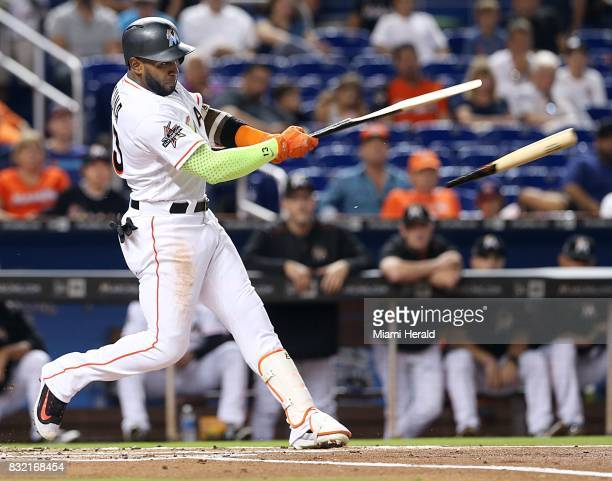 The Miami Marlins' Marcell Ozuna hits a single in the first inning against the San Francisco Giants at Marlins Park in Miami on Tuesday Aug 15 2017