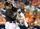 The Miami Marlins' Martin Prado hits an RBI single in the fifth inning against the New York Mets at Marlins Park in Miami on Saturday July 23 2016...