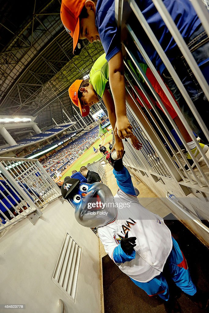 The Miami Marlins mascot Billy the Marlin signs baseballs for young fans during the game against the New York Mets at Marlins Park on September 2, 2014 in Miami, Florida.