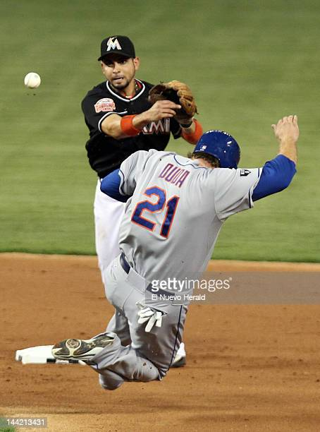 The Miami Marlins' Omar Infante puts out the New York Mets' Lucas Duda at second base during the second inning at Marlins Park in Miami Florida...