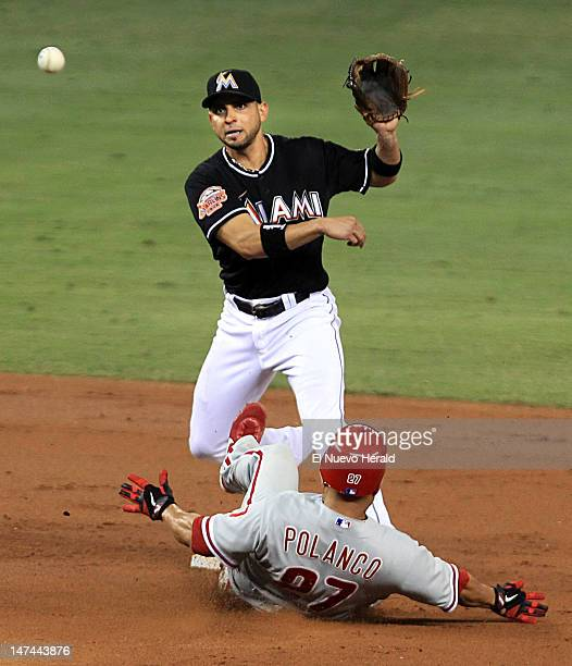 The Miami Marlins' Omar Infante puts out the Philadelphia Phillies' Placido Polanco at second base for a double play in the second inning at Marlins...
