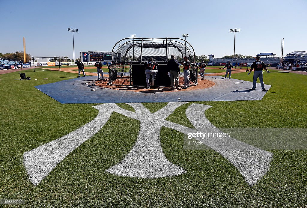 The Miami Marlins take batting practice just before the start of the Grapefruit League Spring Training Game against the New York Yankees at George M. Steinbrenner Field on March 15, 2013 in Tampa, Florida.