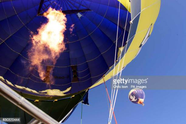 The Michelin team inflate their balloon in Chateau d'Oex for the 22nd Annual International Hot Air Balloon week The Swiss town in the Pays d'Enhaut...