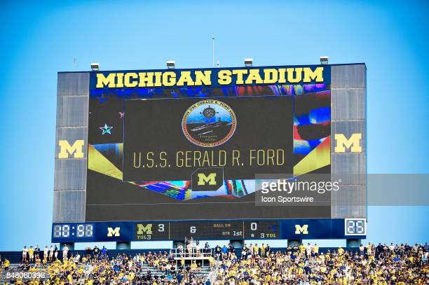 The Michigan scoreboard shows a message from the USS Gerald Ford Aircraft Carrier during the Michigan Wolverines versus US Air Force Academy Falcons...