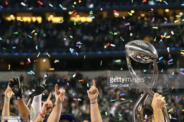 The Michigan State Spartans celebrate after defeating the Baylor Bears during the Goodyear Cotton Bowl Classic at ATT Stadium on January 1 2015 in...