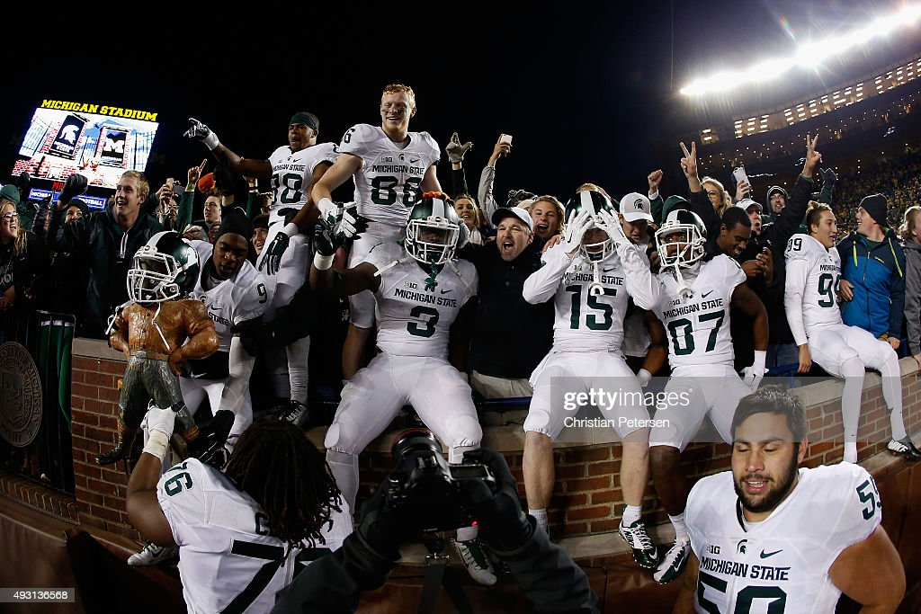 The Michigan State Spartans celebrate after defeating the Michigan Wolverines 2723 in the college football game at Michigan Stadium on October 17...