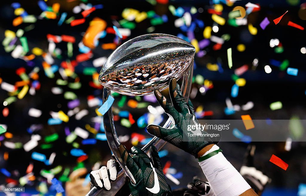 The Michigan State Spartans celebrate with the game trophy after beating the Baylor Bears 4241 during the Goodyear Cotton Bowl Classic at ATT Stadium...