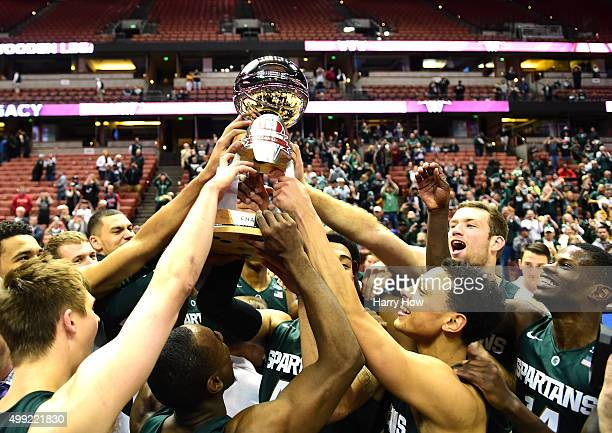 The Michigan State Spartans hold up the tournament trophy in celebration of victory over the Providence Friars during the championship game of the...