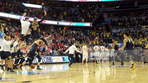 The Michigan Wolverines celebrate as time expires in the Big 10 Tournament Championship game between the Michigan Wolverines and the Wisconsin...