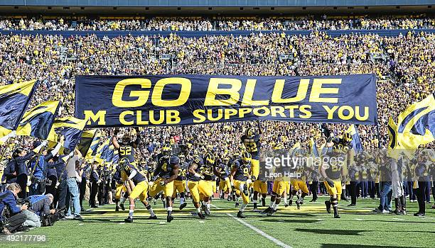 The Michigan Wolverines enter the field prior to the start of the game against the Northwestern Wildcats on October 10 2015 at Michigan Stadium in...