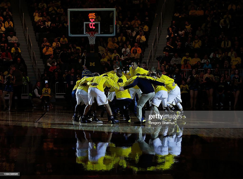 The Michigan Wolverines huddle during player introductions prior to playing the Iowa Hawkeyes at Crisler Center on January 6, 2013 in Ann Arbor, Michigan. Michigan won the game 95-67.