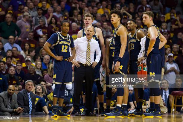 The Michigan Wolverines look on after getting called for a team technical foul in the 2nd half during the Big Ten Conference game between the...
