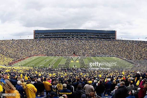 The Michigan Wolverines marching band performs before the college football game against the Michigan State Spartans at Michigan Stadium on October 17...
