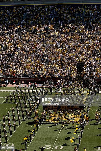 The Michigan Wolverines run onto the field before the game against the Eastern Michigan Eagles at Michigan Stadium on September 19 2009 in Ann Arbor...