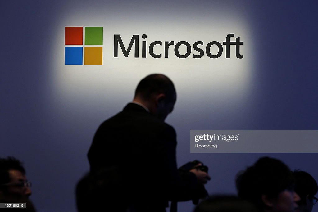 The Microsoft Corp. logo is displayed at a launch event for the company's Windows 8.1 operating system in Tokyo, Japan, on Friday, Oct. 18, 2013. Microsoft Chief Executive Officer Steve Ballmer, who will be retiring within a year, said the company is still working to make sure that the personal computer remains relevant as 'the device of choice.' Photographer: Kiyoshi Ota/Bloomberg via Getty Images