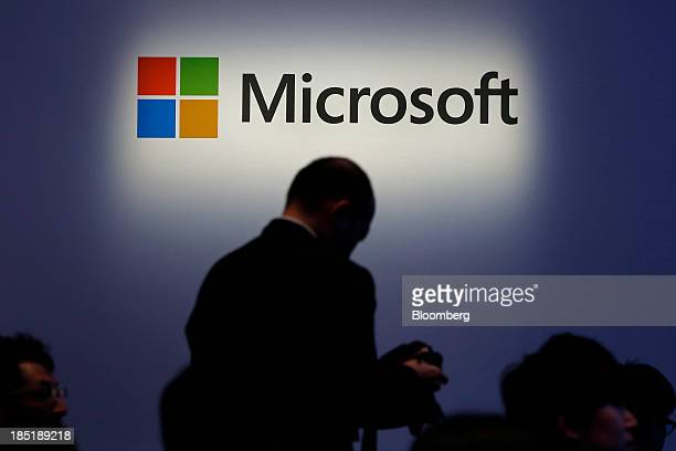 The Microsoft Corp logo is displayed at a launch event for the company's Windows 81 operating system in Tokyo Japan on Friday Oct 18 2013 Microsoft...