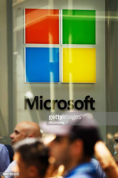 The Microsoft Corp logo is displayed in the window of the company's store in Sydney Australia on Thursday Nov 12 2015 Microsoft opened its first...