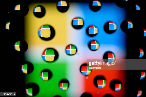 The Microsoft Corp logo is reflected in water droplets for an arranged photograph in Washington DC US on Monday Oct 15 2012 Microsoft Corp is...