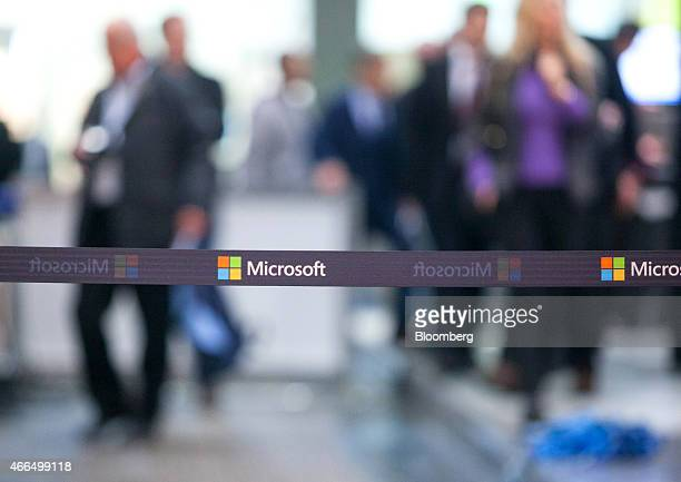 The Microsoft Corp logo is seen on a security cordon during the CeBit tech show in Hanover Germany on Monday March 16 2015 European Commission and...