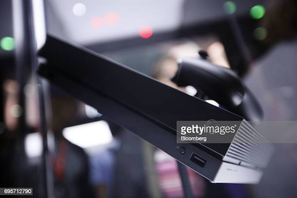 The Microsoft Corp Xbox One X video game console sits on display during the E3 Electronic Entertainment Expo in Los Angeles California US on Tuesday...
