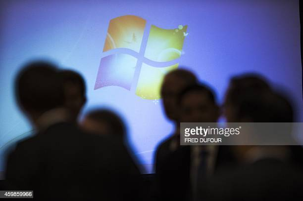 The Microsoft logo appears on screen prior a meeting in Beijing on December 3 2014 AFP PHOTO / FRED DUFOUR
