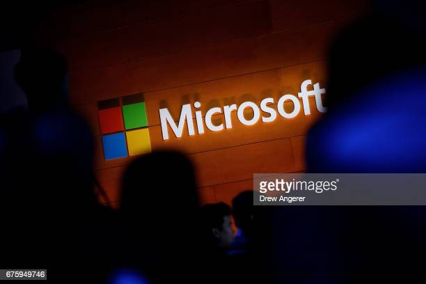 The Microsoft logo is illuminated on a wall during a Microsoft launch event to introduce the new Microsoft Surface laptop and Windows 10 S operating...