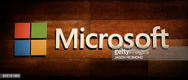 The Microsoft logo is pictured at the Microsoft Annual Shareholders Meeting in Bellevue Washington on November 30 2016 / AFP PHOTO / Jason Redmond