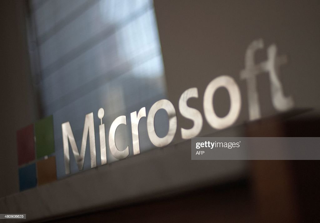 The Microsoft logo is seen before the start of a media event in San Francisco, California on Thursday, March 27, 2014. Satya Nadella, CEO of Microsoft, unveiled a version of Office designed for the iPad today. Microsoft is tapping into its software past as it maps its future in the rapidly changing world of Internet technology.