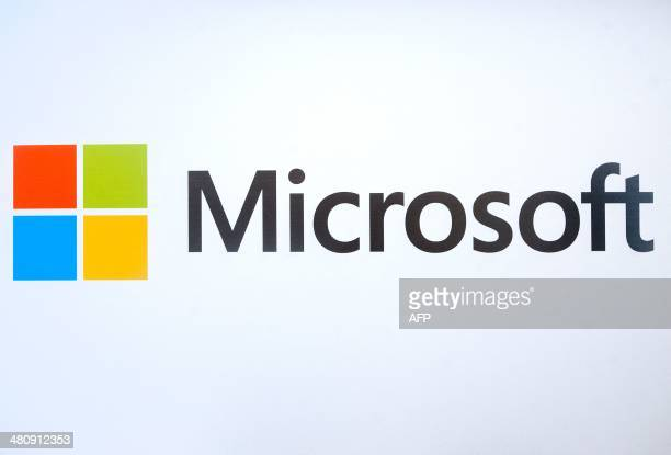 The Microsoft logo is seen before the start of a media event in San Francisco California on Thursday March 27 2014 Satya Nadella CEO of Microsoft...