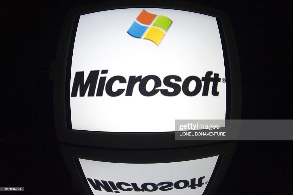 The 'Microsoft' logo is seen on a tablet screen on December 4, 2012 in Paris.