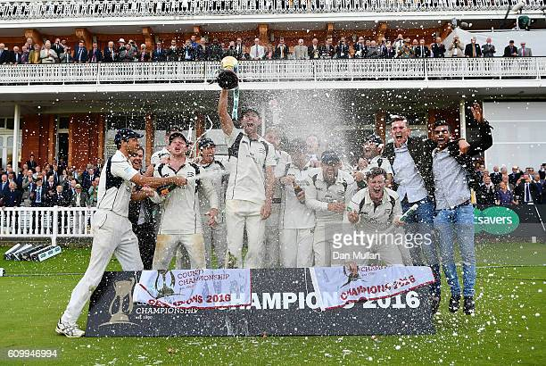 The Middlesex players celebrate with the County Championship trophy following victory during day four of the Specsavers County Championship match...