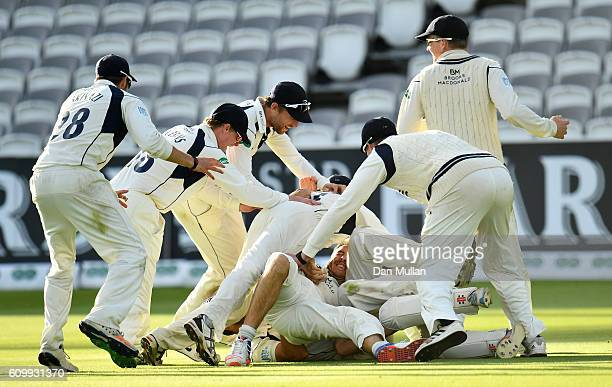 The Middlesex team celebrate victory during day four of the Specsavers County Championship match between Middlesex and Yorkshire at Lords on...