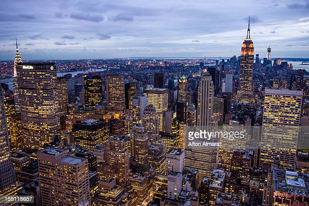 The Midtown skyline remains lit as Lower Manhattan remains mostly without power on November 1 2012 in New York City Millions of customers in New...