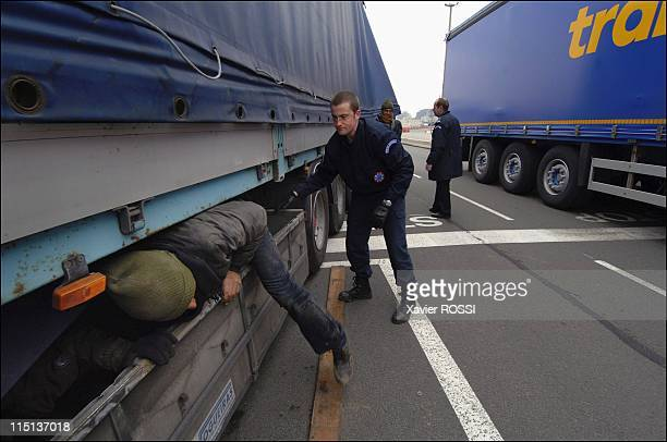 The migrants of Calais to reach Great Britain by all means in Calais France on March 15 2006 Ferry embarkation area The Police frontier arresting...