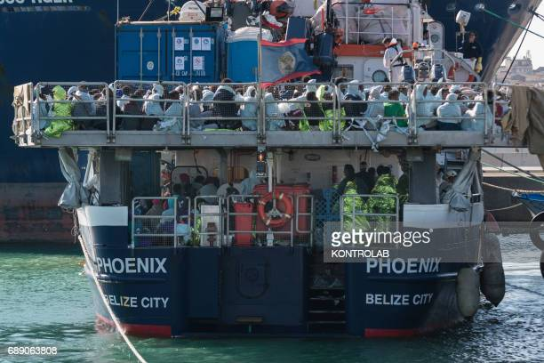 The migrants on the ship during the phase of landing migrants from Phoenix MOAS ship in the port of Crotone Calabria southern Italy 600 refugees...