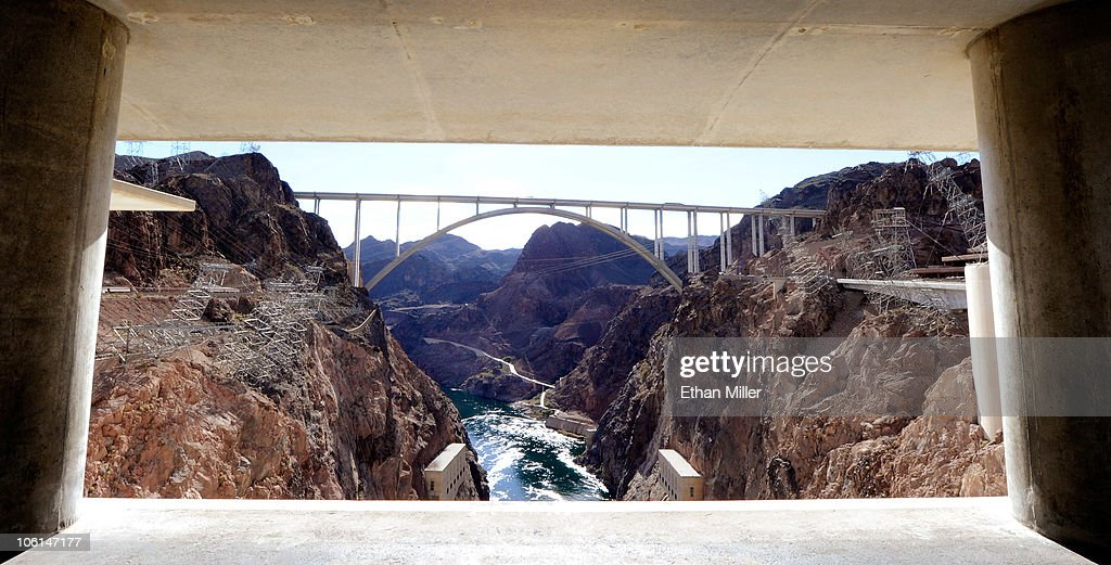 The Mike O'Callaghan-Pat Tillman Memorial Bridge part of the Hoover Dam Bypass Project is framed by the Hoover Dam October 26, 2010 in the Lake Mead National Recreation Area, Nevada. The 1,900-foot-long structure sits 890 feet above the Colorado River, about a quarter of a mile downstream from the Hoover Dam. The USD 240 million four-lane bypass project to relieve vehicle traffic on the Hoover Dam began in 2003, and opened to traffic on October 19.